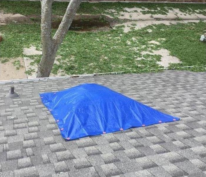 tarp covering broken skylight