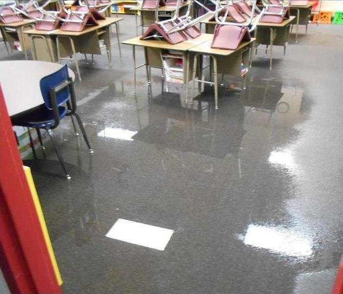 water flooding the floor of a school classroom