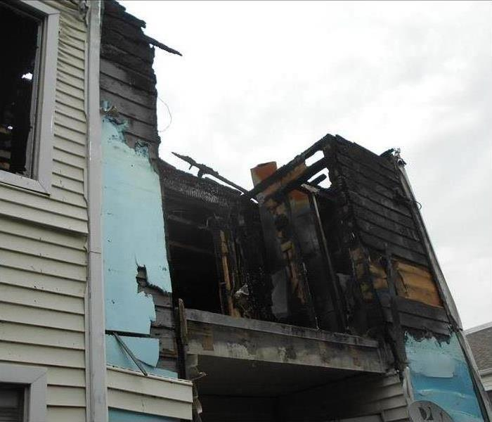 exposed charred remains of apartment after fire
